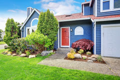 Large blue house with white trim and a nice lawn. Royalty Free Stock Images