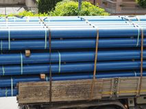 blue pipes on lorry Stock Images