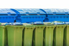Large blue and small green waste containers royalty free stock image