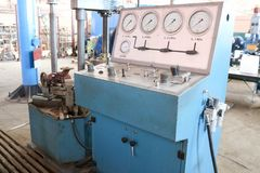 Large blue stand for hydrotesting bolt, pipeline fittings, pressure gauges, leak testing stock photos