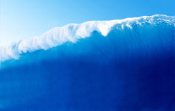Large Blue Surfing Wave Stock Photo