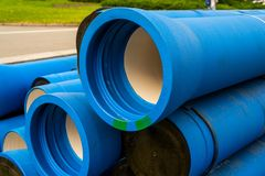 Large blue water pipes for water stock photo