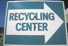 A large blue and white sign indicates a right turn for the recycling center Royalty Free Stock Photography