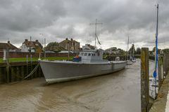 Large boat aground in harbour with low tide, Rye Stock Photography