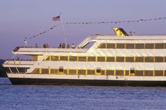 A large boat cruising down the Potomac River in Old Town Alexandria, Washington, D.C. Stock Image