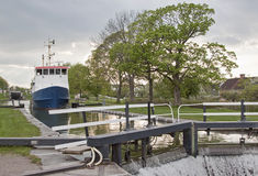 Large boat heading through locks Royalty Free Stock Image