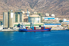 Large boat load next to a refinery stock image