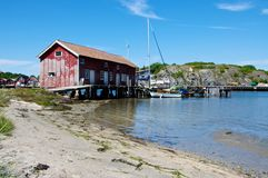 A large boathouse on the Swedish west coast. A large boathouse situated in the straight between the two main islands of the Koster archipelago on the Swedish Stock Images