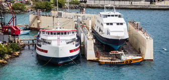 Large Boats in Dry Dock. Boats in Industrial Port in St Thomas, USVI Royalty Free Stock Photos