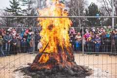 Large bonfire behind fence on holiday carnival stock photos