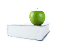 Large book with green apple Stock Photo