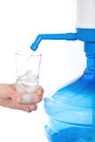 Large bottle of clean drinking water. Large bottle of clean drinking water and hand with glass stock photography