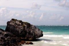 Large Boulder on a Caribbean Beach Left Royalty Free Stock Photos