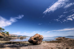 Large boulder on Pacific coast Royalty Free Stock Photo
