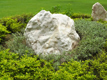 Large boulder placed in the garden Royalty Free Stock Photos