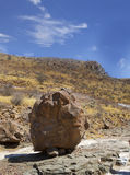 Large Boulder standing at the base of a small mountain in Damaraland - Namibia. A large circular boulder resting at the base of a hill in Damaraland, Namibia Royalty Free Stock Photo