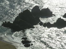 Large boulders California shore line stock images