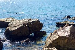 Large boulders lie on the beach in Montenegro Stock Photography
