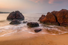 Large boulders and sandy beach Royalty Free Stock Photos