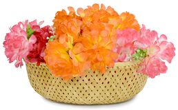 A large bouquet of artificial flowers in the basket Stock Photos