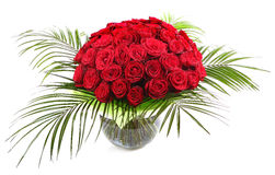 A large bouquet of red roses in a transparent glass vase. The isolated image on a white background. Royalty Free Stock Photos