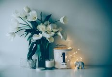 Large bouquet of white spring flowers in a vase, daffodils, tuli Royalty Free Stock Photos