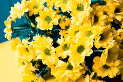 A large bouquet of yellow flowers is in a horizontal position stock photo