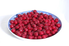 Large bowl of cherries. A huge bowl with lots of cherries, isolated on white Royalty Free Stock Images