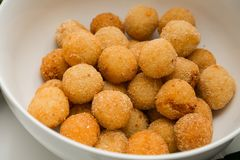 Deep fired cheese balls for catering at a corporate event. Large bowl of deep fired cheese balls for catering at a corporate event gala dinner banquet Stock Image