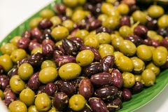 Large bowl of fresh olives for catering at a corporate event. Gala dinner banquet Royalty Free Stock Image