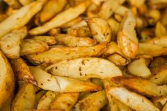 Freshly baked potato wedges for catering at a corporate event. Large bowl of freshly baked potato wedges for catering at a corporate event gala dinner banquet Stock Image