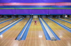 Large Bowling Alley With A Ball Rolling Down The Lane