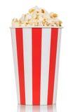 Large box of delicious fresh popcorn isolated on white stock images