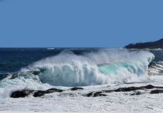 Free Large Breaking Wave Hitting The Shoreline With A Big Splash Stock Photos - 147512083