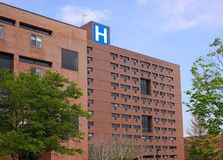 Large brick building with letter H sign Royalty Free Stock Photography