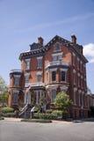Large brick home. Large luxurious brick home with lush vegetation Stock Images