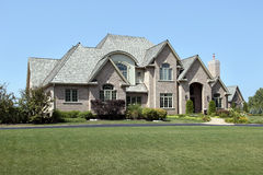 Large brick home with arched entry Stock Image