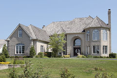 Large brick home with arched entry Royalty Free Stock Images