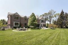 Large brick home and back yard stock photo