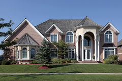 Large brick home with columned entryway Royalty Free Stock Photos