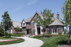 Large brick home with stone entry Royalty Free Stock Photo