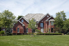 Large brick home in suburbs Royalty Free Stock Photography