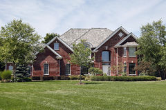 Large brick home in suburbs Stock Images