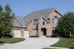 Large brick home with three car garage Stock Image