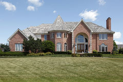 Large brick home with turret Royalty Free Stock Image