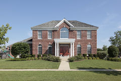 Large brick home with white columns Royalty Free Stock Image