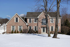 Large brick home in winter Royalty Free Stock Image