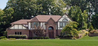 Large Brick House. Large, luxurious, red brick with stucco house in suburban neighborhood Royalty Free Stock Photography