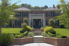 Large Brick Luxury Home. Exterior shot of a large, brick luxury home with a stately entrance Royalty Free Stock Photography