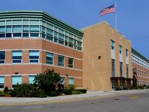 Large brick school type building. With American flag stock photo